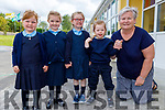 Junior infants, Maeve Culloty, Elora Reidy, Freya Russell and Evelyn Burke with principal  Sinead Murphy in Clogher NS on Monday.
