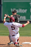 #32 of the Cal Poly Mustangs pitches against the Loyola Marymount Lions at Page Stadium on February 25, 2012 in Los Angeles,California. Cal Poly defeated LMU 12-5.(Larry Goren/Four Seam Images)