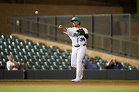 Salt River Rafters third baseman Colton Welker (34), of the Colorado Rockies organization, throws to first base during an Arizona Fall League game against the Mesa Solar Sox on September 19, 2019 at Salt River Fields at Talking Stick in Scottsdale, Arizona. Salt River defeated Mesa 4-1. (Zachary Lucy/Four Seam Images)