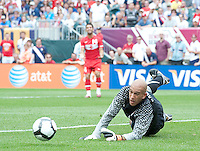 USA's Tim Howard dives for a ball during an international friendly tune up match against Turkey for the 2010 World Cup, at Lincoln Financial Field, in Philadelphia, PA, Saturday, May 29, 2010. USA defeated Turkey 2-1.