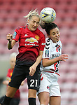 Millie Turner of Manchester United Women and Liz Ejupi of Charlton Athletic Women