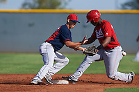Cleveland Indians Sam Haggerty (16) waits for a throw as Raul Wallace (47) slides into second during an instructional league game against the Cincinnati Reds on October 17, 2015 at the Goodyear Ballpark Complex in Goodyear, Arizona.  (Mike Janes/Four Seam Images)