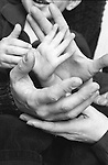 family's hands - mother, father and 3 year old son