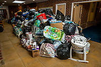 BNPS.co.uk (01202 558833)<br /> Pic: MaxWillcock/BNPS<br /> <br /> Pictured: The pile of donations.<br /> <br /> A flood of donations for Afghan refugees has inundated a church which has been left with a 24ft long stack of parcels.<br /> <br /> Ross Donaldson posted on a Facebook community group asking if anyone had clothes to offer, sparking an overwhelming response from his community.<br /> <br /> After organising to keep donations at Immanuel Church, Bournemouth, Dorset, he arrived the next morning to find a pile of bags.