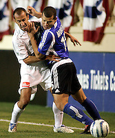 SAN JOSE, CA--San Jose Earthquakes forward Alejandro Moreno battles against La Galazy midfielder and captain Peter Vagenas at Spartan Stadium in San Jose. The LA Galaxy defeated the San Jose Earthquakes to win the first round playoffs with an aggregate score of three goals to one at Spartan Stadium in San Jose, California on Saturday, October 29, 2005. PHOTO BY DON FERIA. SATURDAY, OCTOBER 29 2005.