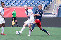 FOXBOROUGH, MA - JULY 4: Tyler Polak #3 of Greenville Triumph SC passes the ball as Jake Rozhansky #32 of the New England Revolution II comes in to tackle during a game between Greenville Triumph SC and New England Revolution II at Gillette Stadium on July 4, 2021 in Foxborough, Massachusetts.