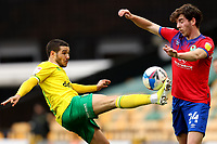 20th March 2021; Carrow Road, Norwich, Norfolk, England, English Football League Championship Football, Norwich versus Blackburn Rovers; Emi Buendia of Norwich City competes for the ball with Joseph Rankin-Costello of Blackburn Rovers