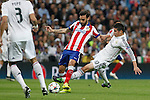 Real Madrid's James Rodriguez (R) and Atletico del Madrid´s Jesus Gamez during quarterfinal second leg Champions League soccer match at Santiago Bernabeu stadium in Madrid, Spain. April 22, 2015. (ALTERPHOTOS/Victor Blanco)