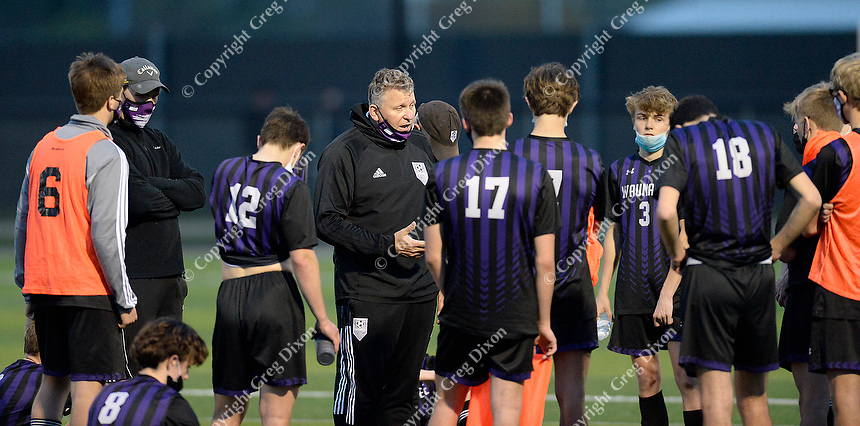 Waunakee head coach, Dave Kettner, talks to players at the half, as Oregon takes on Waunakee in Wisconsin WIAA Badger Conference boys high school soccer on Tuesday, Apr. 27, 2021 at Waunakee High School