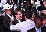 Republican presidential candidate, former Massachusetts Gov. Mitt Romney greets Nevada Lt. Gov. Brian Krolicki, center, and Sen. James Settelmeyer following a rally in Reno, Nev., on Wednesday, Oct. 24, 2012. (AP Photo/Cathleen Allison)