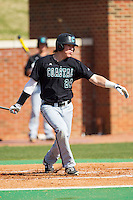 Colin Hering (24) of the Coastal Carolina Chanticleers follows through on his swing against the High Point Panthers at Willard Stadium on March 15, 2014 in High Point, North Carolina.  The Chanticleers defeated the Panthers 1-0 in the first game of a double-header.  (Brian Westerholt/Four Seam Images)
