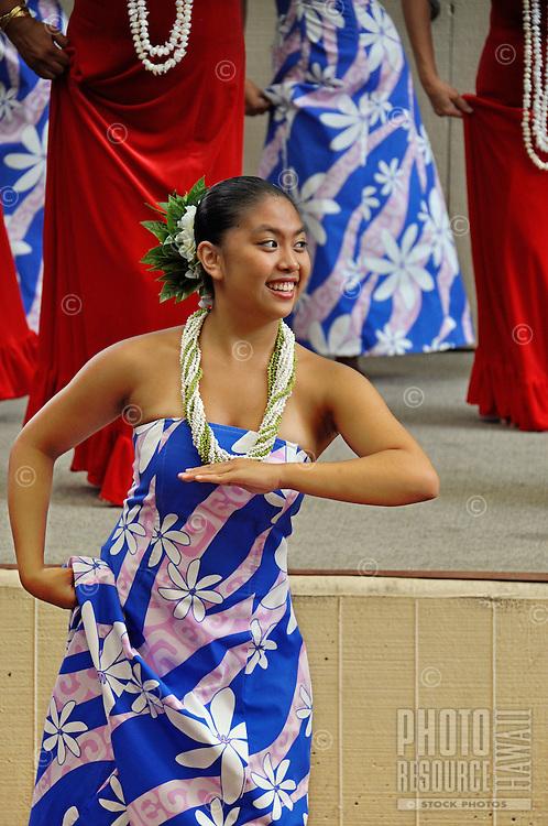 Women wearing shell lei perform  hula at Ward Warehouse shopping center in Honolulu, O'ahu.