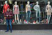 Man outside a clothing store in Oxford Street, London.