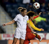 Christine Rampone (3) of the USWNT goes up for a header against Wang Yihang (9) of China during an international friendly at PPL Park in Chester, PA.  The U.S. tied China, 1-1.