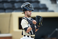 Wake Forest Demon Deacons catcher Logan Harvey (15) prior to the game against the Liberty Flames at David F. Couch Ballpark on April 25, 2018 in  Winston-Salem, North Carolina.  The Demon Deacons defeated the Flames 8-7.  (Brian Westerholt/Four Seam Images)