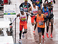 4th October 2020, London, England; 2020 London Marathon; Eliud Kipchoge (KEN) (attempts to grab a drink during the Elite Men's Race. The historic elite-only Virgin Money London Marathon taking place on a closed-loop circuit around St James's Park in central London on Sunday 4 October 2020.