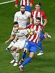 Atletico de Madrid's Filipe Luis (t-r) and Yannick Ferreira Carrasco (d-r) and Real Madrid's Daniel Carvajal (t-l) and Lucas Vazquez during La Liga match. November 19,2016. (ALTERPHOTOS/Acero)
