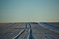 Snow covers farm fields outside Ledger, Montana, USA.