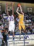 McNeese State Cowboys forward Daniel Richard (54) shoots over Texas-Arlington Mavericks forward Brandon Edwards (35) during the game between the McNeese State Cowboys and the UTA Mavericks held at the University of Texas at Arlington's, Texas Hall, in Arlington, Texas.  McNeese State defeats UTA 81 to 72.