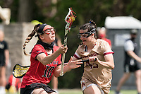NEWTON, MA - MAY 14: Cameryn Dera #10 of Fairfield University on the attack as Sydney Scales #45 of Boston College defends during NCAA Division I Women's Lacrosse Tournament first round game between Fairfield University and Boston College at Newton Campus Lacrosse Field on May 14, 2021 in Newton, Massachusetts.