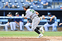 Augusta GreenJackets center fielder Ismael Munguia (34) runs to first base during a game against the Asheville Tourists at McCormick Field on April 7, 2019 in Asheville, North Carolina. The GreenJackets  defeated the Tourists 11-2. (Tony Farlow/Four Seam Images)