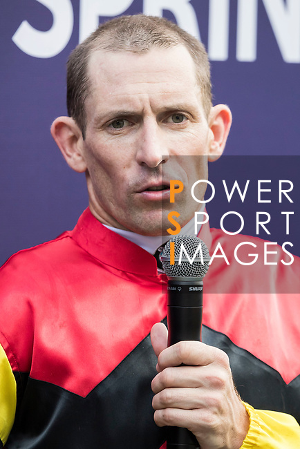 Jockey Hugh Bowman talks during the post race interview after his horse Lucky Bubbles won the Chairman's Sprint Prize (1200m) on 07 May 2017, at the Sha Tin Racecourse  in Hong Kong, China. Photo by Chris Wong / Power Sport Images