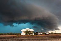 Shelf cloud from a thunderstorm w/ a glowing blue precipitation core approaching storm chase vehicles in West Texas, May 24, 2014