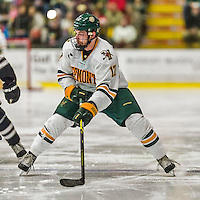 29 December 2014: University of Vermont Catamount Forward Jake Fallon, a Senior from Southlake, Texas, in second period action against the Providence College Friars, during the deciding game of the annual TD Bank-Sheraton Catamount Cup Tournament at Gutterson Fieldhouse in Burlington, Vermont. The Friars shut out the Catamounts 3-0 to win the 2014 Cup. Mandatory Credit: Ed Wolfstein Photo *** RAW (NEF) Image File Available ***