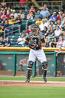 Jett Bandy (27) of the Salt Lake Bees on defense against the Las Vegas 51s in Pacific Coast League action at Smith's Ballpark on June 25, 2015 in Salt Lake City, Utah. Las Vegas defeated Salt Lake 20-8. (Stephen Smith/Four Seam Images)