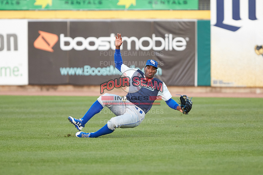 Lexington Legends right fielder Seuly Matias (25) tries to make a sliding catch during the game against the West Virginia Power at Appalachian Power Park on June 7, 2018 in Charleston, West Virginia. The Power defeated the Legends 5-1. (Brian Westerholt/Four Seam Images)