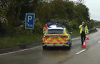Pictured: Police and traffic officers by the car that veered off the A4232 near Cardiff, Wales, UK. Friday 28 May 2021<br /> Re: Police and traffic officers attended a road traffic accident in which a car veered off the northbound carriageway of the A4232 near junction 33 and ended up in trees at the side of the road just before mid-day near Cardiff, Wales, UK.