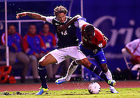 SAN JOSE, COSTA RICA - September 06, 2013: Jermaine Jones (13) of the USA MNT battles for the ball with Joel Campbell (12)of the Costa Rica MNT during a 2014 World Cup qualifying match at the National Stadium in San Jose on September 6. USA lost 3-1.