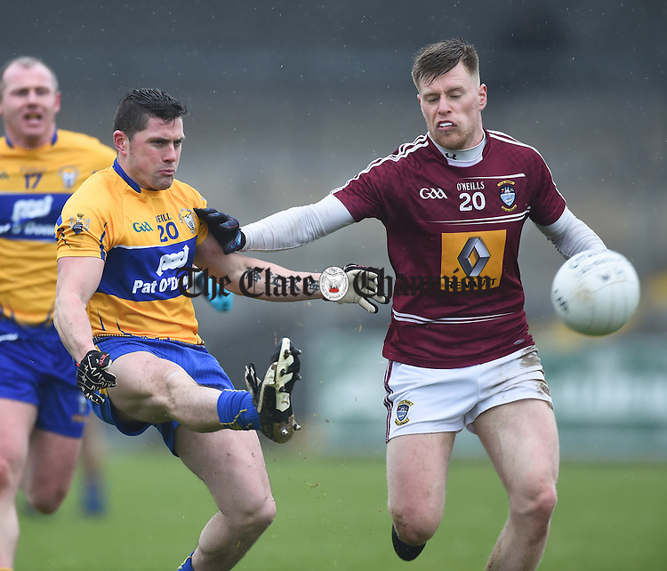 Graham Kelly of Clare in action against Shane Flanagan of Westmeath during their league game in Cusack Park. Photograph by John Kelly.