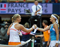 Arena Loire,  Trélazé,  France, 16 April, 2016, Semifinal FedCup, France-Netherlands, Kiki Bertens (NED) wins the match and puts the Netherlands in a 2-1 lead, and is congratulated by Kristina Mladenovic (R)<br /> Photo: Henk Koster/Tennisimages