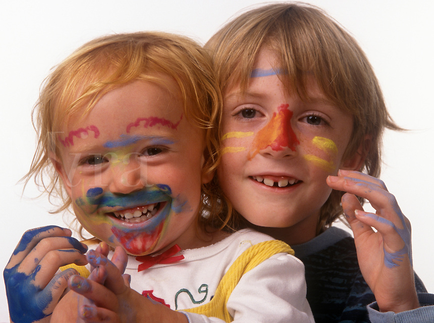 BOY & GIRL WITH PAINTED FACES