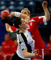 BELGRADE, SERBIA - DECEMBER 15:  Anna Punko of Russia (L)  is challenged by Pernille Holst Larsen (R) of Denmark during the Women's European Handball Championship 2012 fifth place match between Denmark and Russia at Arena Hall on December 15, 2012 in Belgrade, Serbia. (Photo by Srdjan Stevanovic/Getty Images)