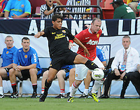 FC Barcelona midfielder Jonathan Dos Santos (18) shields the ball against Manchester United forward Wayne Rooney (10) Manchester United defeated Barcelona FC 2-1 at FedEx Field in Landover, MD Saturday July 30, 2011.