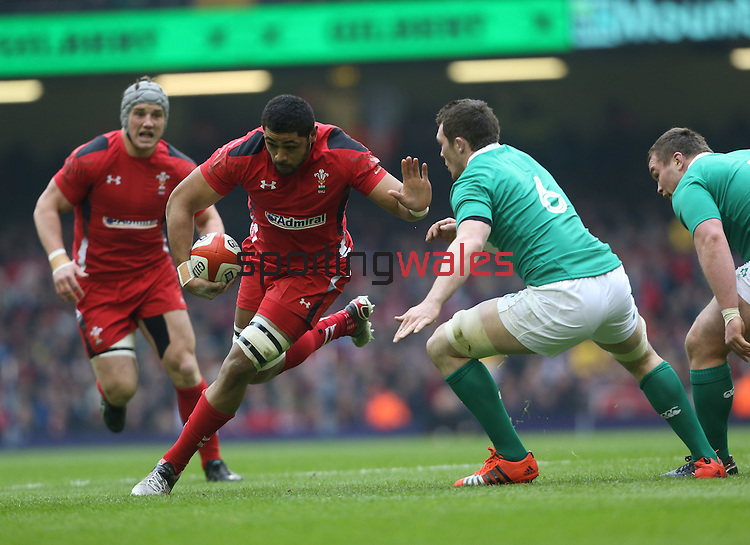 Wales number 8 Taulupe Faletau takes on Irish flanker Peter O'Mahony.<br /> RBS 6 Nations<br /> Wales v Ireland<br /> Millennium Stadium<br /> 14.03.15<br /> ©Steve Pope - SPORTINGWALES