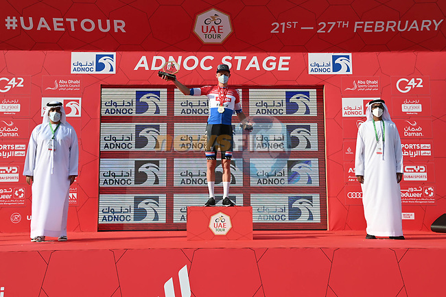 Mathieu van der Poel (NED) Alpecin-Fenix on the podium with Mubarak Al Mansouri, Vice President Al Dhafra Region ADNOC, and Naser Mohamed Al Mansoori, Acting Undersecretary for the Ruler Representative Court after winning Stage 1 of the 2021 UAE Tour the ADNOC Stage running 176km from Al Dhafra Castle to Al Mirfa, Abu Dhabi, UAE. 21st February 2021.  <br /> Picture: LaPresse/Gian Mattia D'Alberto | Cyclefile<br /> <br /> All photos usage must carry mandatory copyright credit (© Cyclefile | LaPresse/Gian Mattia D'Alberto)
