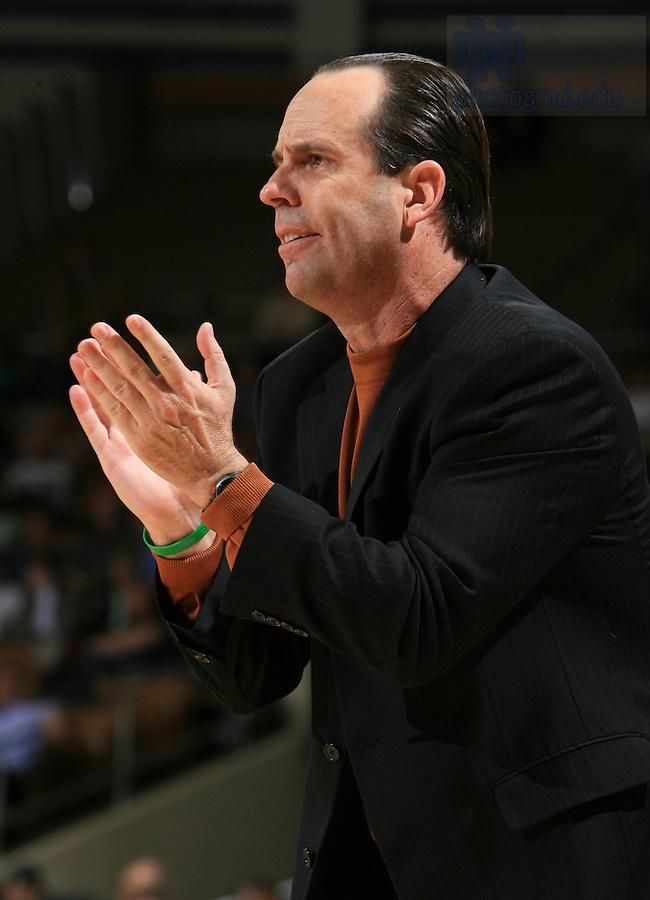 Notre Dame Fighting Irish head coach Mike Brey yells to his team.