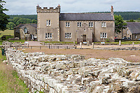 Cumbria, England, UK.  Birdoswald Fort, Hadrian's Wall Footpath. Victorian-era house seen from the western wall of the fort.