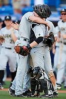Army West Point relief pitcher Daniel Burggraaf (33) embraces catcher Jon Rosoff (7) after closing out a game against the Michigan Wolverines on February 17, 2018 at First Data Field in St. Lucie, Florida.  Army defeated Michigan 4-3.  (Mike Janes/Four Seam Images)