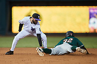 Yoney Frajardo (32) of the Greensboro Grasshoppers is tagged out by Jagger Rusconi (22) of the Winston-Salem Dash as he attempts to steal second base at Truist Stadium on August 11, 2021 in Winston-Salem, North Carolina. (Brian Westerholt/Four Seam Images)