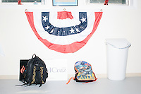 Backpacks lay next to a trash can before Texas senator and Republican presidential candidate Ted Cruz speaks to a crowd at the kick-off event at his New Hampshire campaign headquarters in Manchester, New Hampshire.