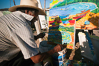 Street side artist painting in sunshine, Sayulita, Mexico