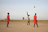 Young women of the Turalai team practice their volleyball at the Twic Olympics in Wunrok, Southern Sudan.