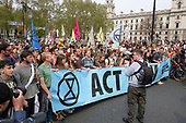 Extinction Rebellion climate change campaigners marching from Marble Arch arrive at Parliament Square, London.