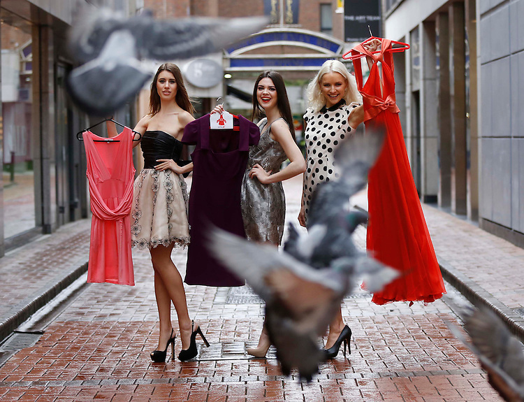 """No Repro Fee..Models, Joanne Northey,(left) with Clare MacDougald and Teo Sutra (right), pictured holding dresses donated by Nuala Carey, Lisa Cannon and Caroline Harrington in Dublin at the launch of the """"Buy My Dress 2013"""" supported by Kellogg's Special K in aid of the Down Syndrome Centre which takes place around the country on the 26th May. Pic. Robbie Reynolds"""