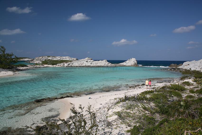 Couple on beach, Staniel Cay, Bahamas