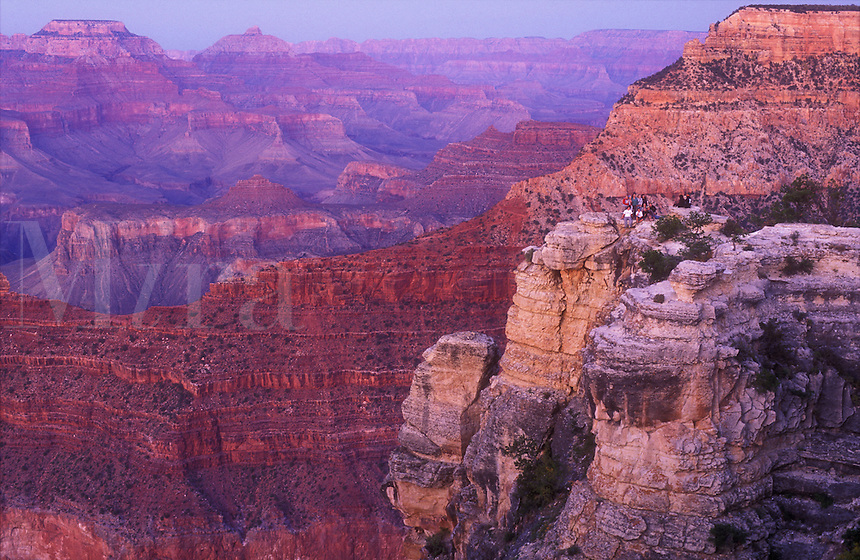 USA, Arizona, Grand Canyon National Park, view of Mathers Point at dusk with a group of people